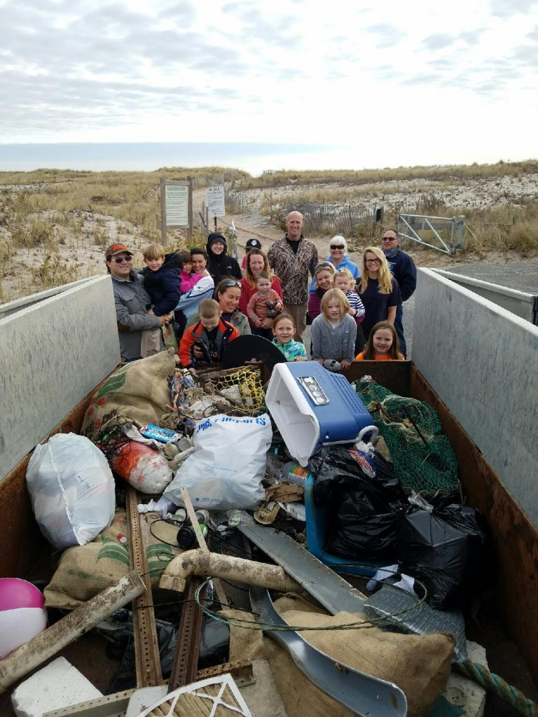 It takes a whole village to clean the beach!